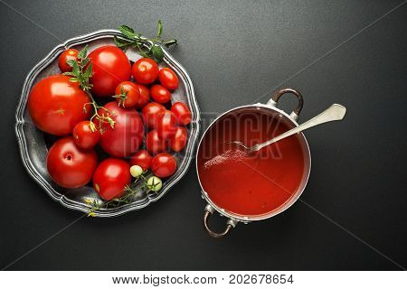 Fresh tomatoes for sauce and soup on black background
