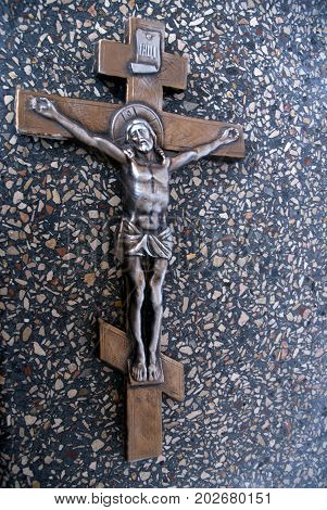 Silhouette of the crucified Jesus Christ on the cross the background of granite stones. The biblical prophet is the symbol of death. Mountain Calvary Christmas Easter background.
