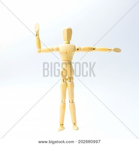 Wooden figure doll with extend the arms emotion for exercise concept on white background.