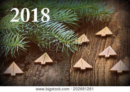 Frame from decorated Christmas tree on rustic wooden background with copy space for text. Happy New Year concept. Holiday background. Christmas mock-up or greeting card .