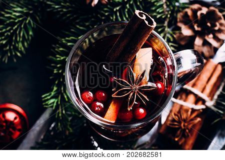 Mulled wine with cowberry cinnamon orange and anise. Christmas or New Year Winter drink. Copy space top view