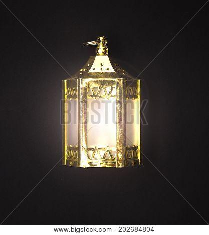 Christmas lantern lamps isolated on black background.