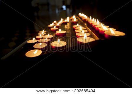candles lits  in catholic church, religion concept