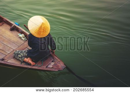 A woman rowing boat in Cai Rang Vietnam.