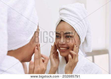 Young Asian Woman With Bath Towels Cleanses Her Face