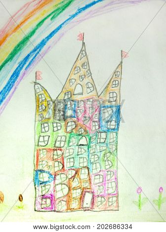 Children's color pencil drawing depicting a multi-storey house and a rainbow
