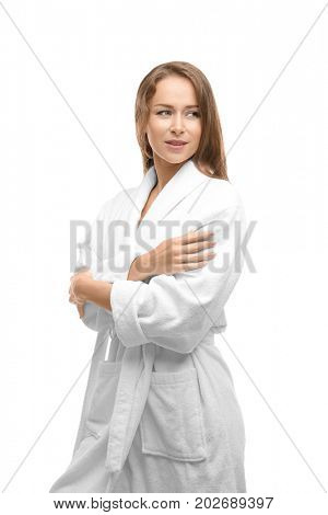 Beautiful young woman in bathrobe after shower on white background