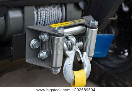 Detail photo of the car winch on Metal background