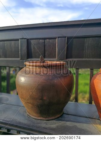earthen jar Thai House on Abstract background