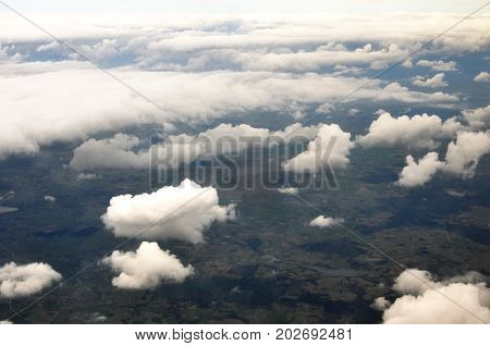 Sky scenery. Aerial view over the cumulus clouds.