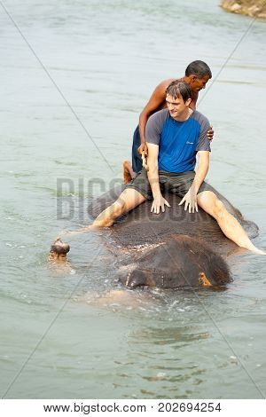Male Tourist Submerged Elephant Ride River Nepal