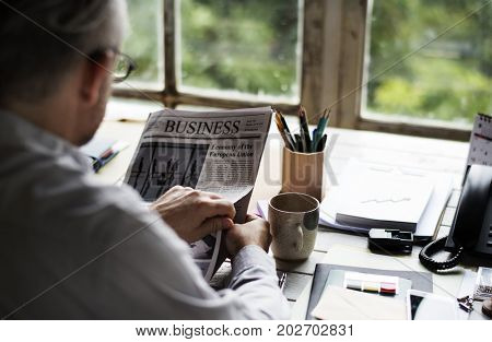Business people Reading Newspaper at Office Updating News