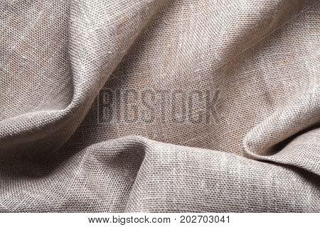 Background of linen napkin folded in folds horizontal