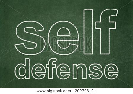 Privacy concept: text Self Defense on Green chalkboard background
