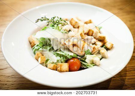 Caesar salad. Romano salad, cherry tomatoes parmesan sauce