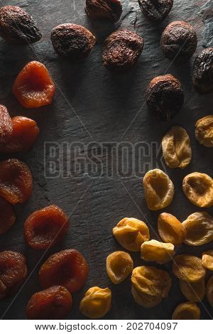 Frame of dried multi-colored dried apricots vertical