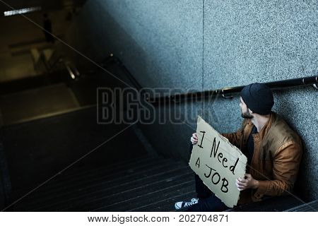 Homeless Man Asking For Job Sitting on Stairway Sidewalk