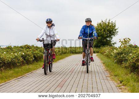 Women riding bicycles
