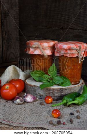 Jars Of Tomato Sauce With Chili, Pepper And Garlic. Bolognese Sauce, Lecho Or Adjika. Preservation.