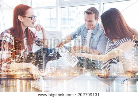 Genius thought. Close up of smart diligent team talking about business while looking at the document and showing interest