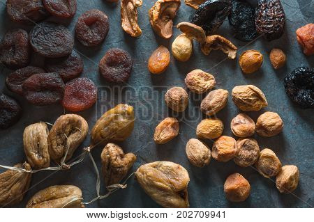 Background of dried fruits dried apricots, figs and pears horizontal
