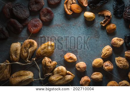 Frame of dried fruits dried apricots, figs and pears horizontal