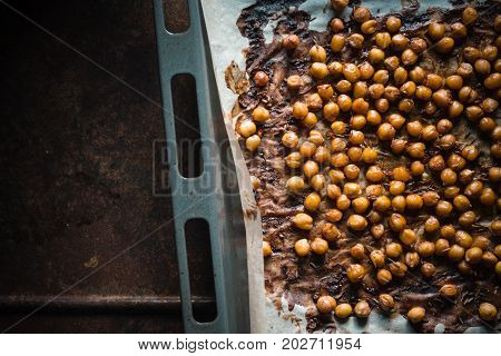 Nut in caramel crust on parchment on a baking sheet on a metal table horizontal