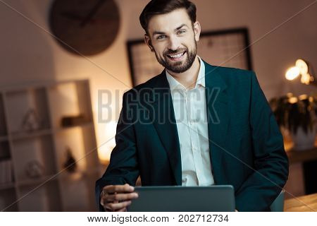 Follow me. Handsome office worker expressing positivity and raising eyebrows while looking forward