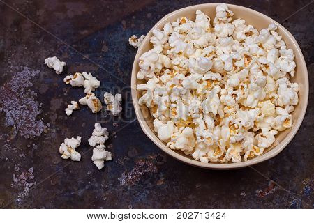 Popcorn in a bowl on a grunge background