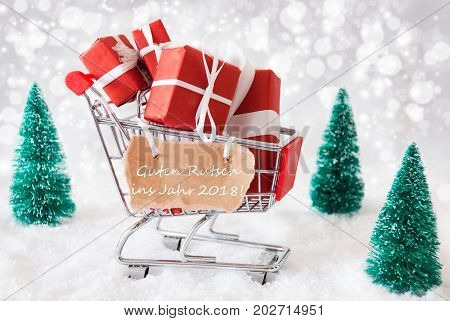 Trollye With Christmas Presents Or Gifts. Snowy Scenery With Snow And Trees. Sparkling Bokeh Effect. Label With German Text Guten Rutsch Ins Jahr 2018 Means Happy New Year