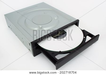 Open-ended CD - DVD drive with a black cap and disk inside. Isolated on white background.