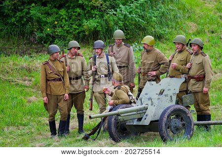 Heavy artillery and soldiers.The VIII International Festival of Military History and remake for the battle `1944` 6.08.2016 in Valga, Estonia