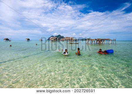 Semporna, Malaysia - April 17, 2015: Young Bajau Laut  Boys Playing At The Beach In Maiga Island In
