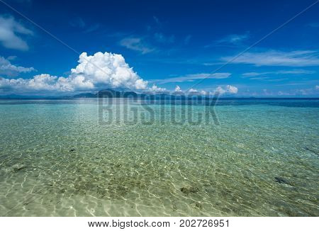 Beautiful Beach View With Clear Water And Blue Sky At Sibuan Island At Celebes Sea In The Vicinity O