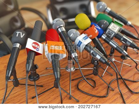 Press conference or interview concept. Microphones of different mass media, radio, tv and press prepared for conference meeting. 3d illustration