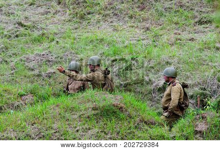Soldiers in trenches before the battle.The VIII International Festival of Military History and remake for the battle `1944` 6.08.2016 in Valga, Estonia