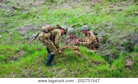 Digging the trench.The VIII International Festival of Military History and remake for the battle `1944` 6.08.2016 in Valga, Estonia