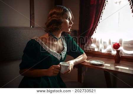 Woman in vintage train, rich compartment interior