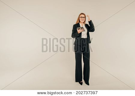 Confident In Her Abilities. Girl Businesswoman With Tablet Studying News And Presentation Ideas. Wit