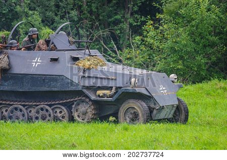 Military vechicle moving towards battleground.The VIII International Festival of Military History and remake for the battle `1944` 6.08.2016 in Valga, Estonia