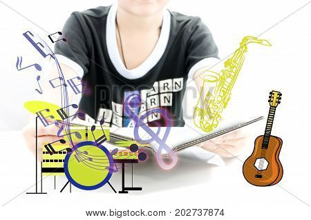 Boy learning for new experience with musical equipment for begin play