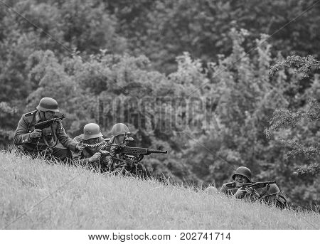Battle with armed forces black and white.The VIII International Festival of Military History and remake for the battle