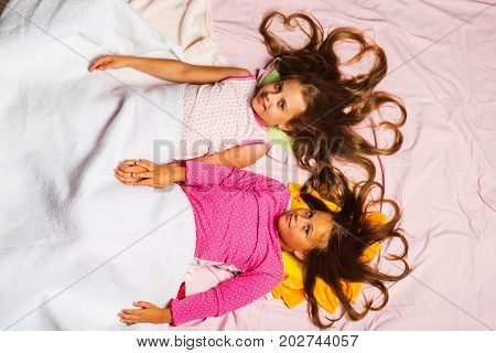 Childhood And Morning Concept. Kids In Pink Pajamas
