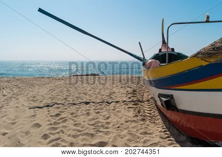 Arte Xavega typical portuguese old fishing boat on the beach in Paramos Espinho Portugal.