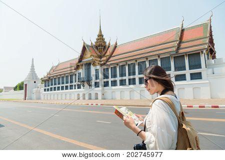 Pretty Tourist Woman Reading Travel Guidebook
