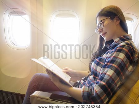Successful Business Woman Taking The Airplane
