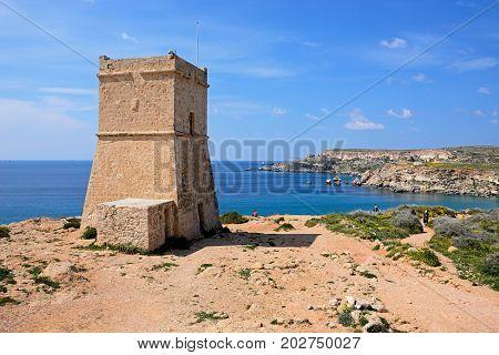 GOLDEN BAY, MALTA - MARCH 29, 2017 - Ghajn Tuffieha watchtower overlooking the sea and cliffs Golden Bay Malta Europe, March 29, 2017.