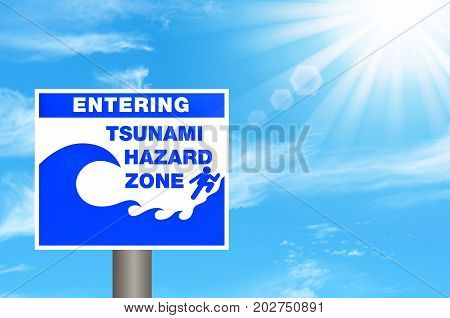 Tsunami Hazard Zone Warning Sign On Blue Sky And Sun Light White Clouds Background.