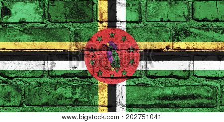 Dominica flag painted on the brick wall