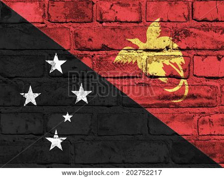 Papua New Guinea flag painted on the brick wall